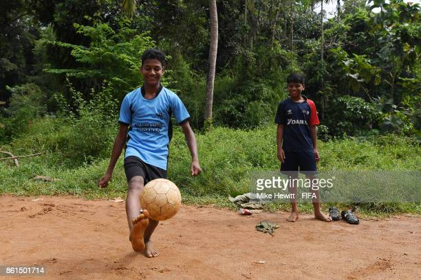 Young children enjoy a game of football during the FIFA U17 World Cup India 2017 tournament at on October 15 2017 in Kochi India