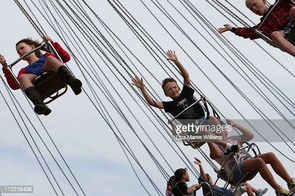 Young children enjoy a ride in Sideshow Alley during the Royal Easter Show at Sydney Olympic Park on April 15 2011 in Sydney Australia The iconic...