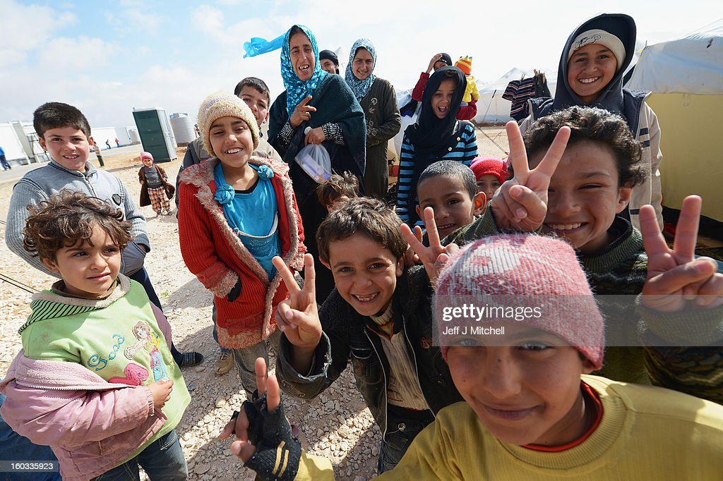 Young children gesture as Syrian refugees go about their daily business in the Za'atari refugee camp on January 29 2013 in Mafraq Jordan Record...