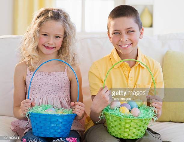 Young children holding Easter baskets