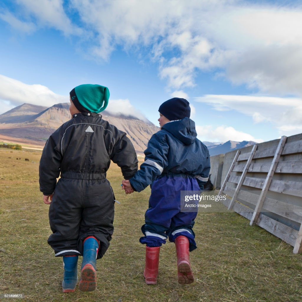 Young children holding hands, Iceland