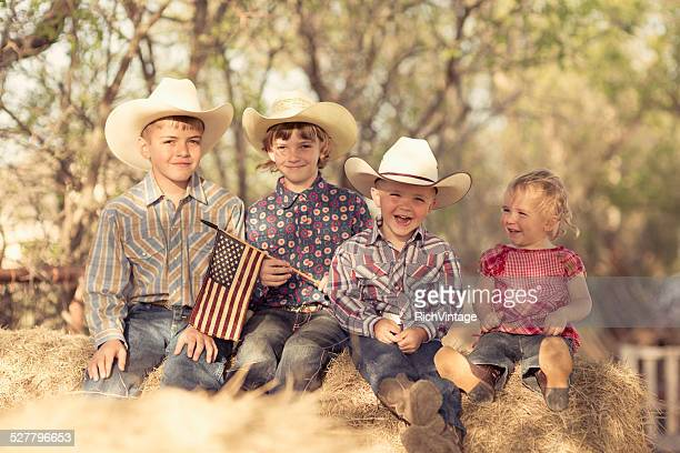 Young Children in Western Wear hold American Flag