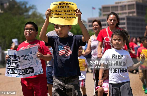 Young children join immigration reform protesters while marching in front of the White House July 7 2014 in Washington DC During the rally...