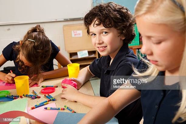Young children make projects in art class