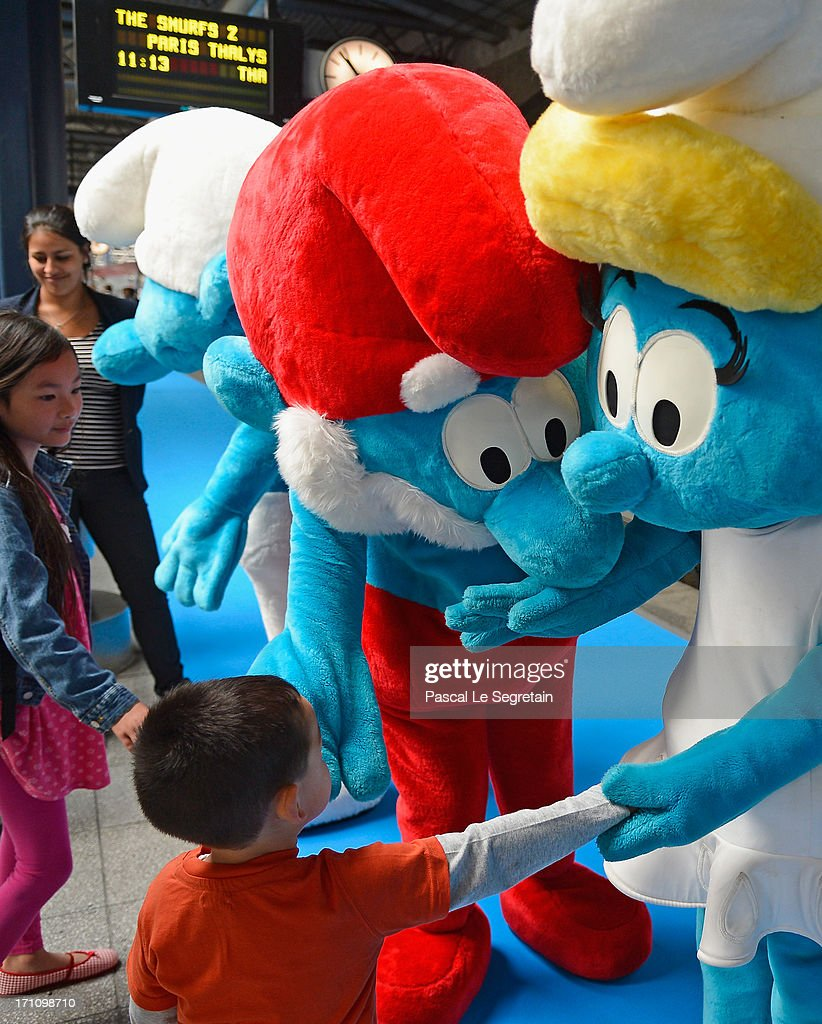 Young children meet with Smurf characters as Smurf Ambassadors prepare to board a branded high speed train from Brussels to Paris as part of Global Smurfs Day celebrations on June 22, 2013 at Brussels railway station, Belgium.