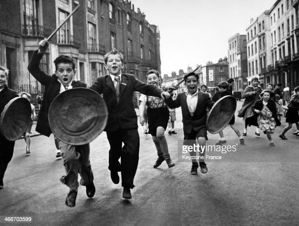 Young children of Paddington neighbourhood with dustbin lids for shields and bits of wood for lances defend their street from the invasion of our...