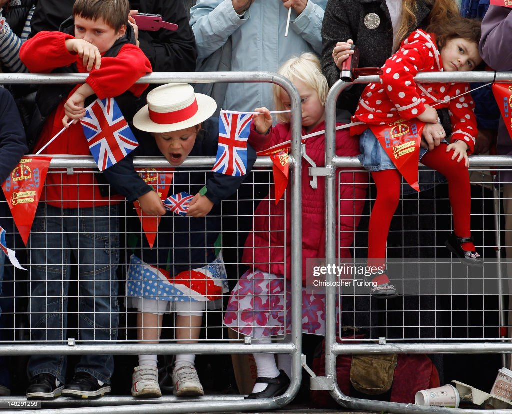 Young children patiently wait to greet the Queen outside Nottingham Town Hall during her visit to the East Midlands on June 13, 2012 in Nottingham, England. The Queen was accompanied by Prince William, Duke of Cambridge and Catherine, Duchess of Cambridge, during her official visit to the East Midlands. Prince William will later make his official tribute to the Queen for the Jubilee.