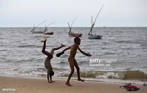 Young children play on a beach in Maputo on January 10 2014 AFP PHOTO / ALEXANDER JOE