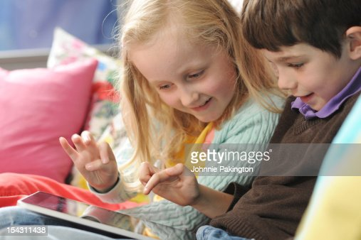 Young Children Playing on Tablet Computer : Stock Photo