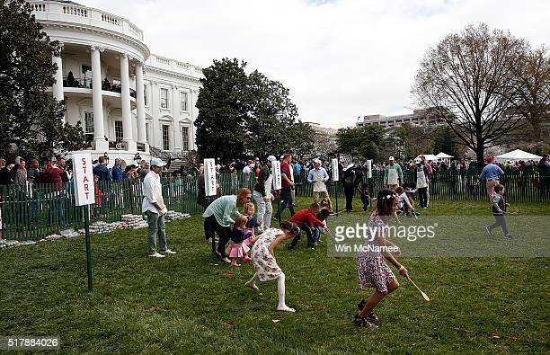 S Young children roll Easter eggs on the South Lawn of the White House during the annual White House Easter Egg Roll March 28 2016 in Washington DC...