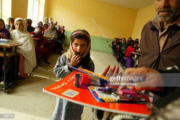 Young children sit at their desks at their classroom on the first day of school March 23 2002 at the Ariana High School in Kabul Afghanistan Kabul...
