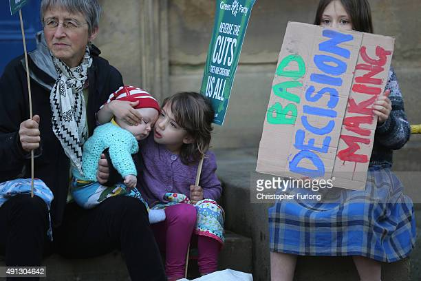 Young children take part take part in an antiausterity protest during the first day of the Conservative Party Autumn Conference 2015 on October 4...