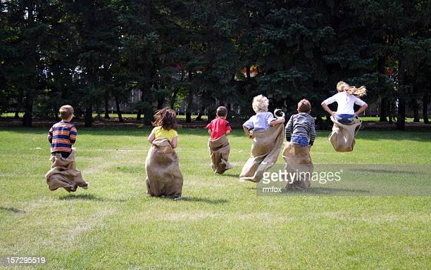 Young children taking part in a sack race