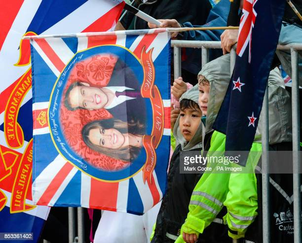 Young children wait in the rain to see the Duke and Duchess of Cambridge before their walkabout in Civic Square Wellington New Zealand during their...