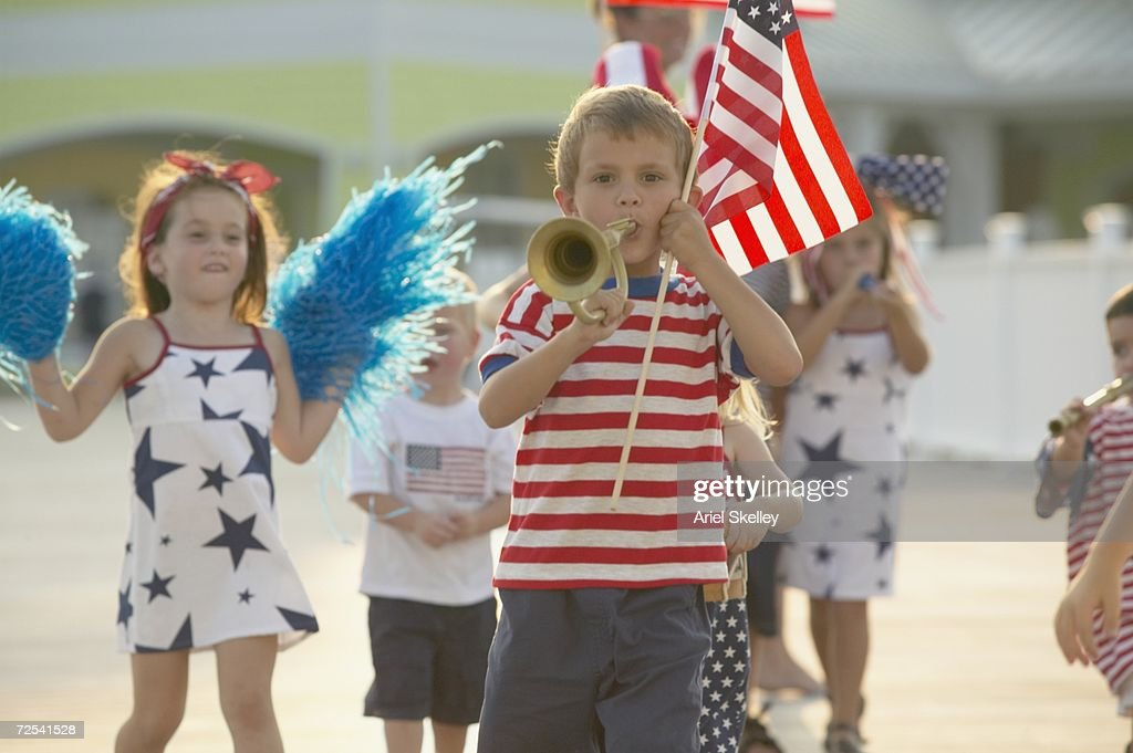 Young children walking in Fourth of July parade : Stock Photo