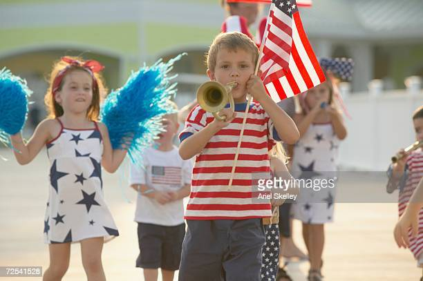 Young children walking in Fourth of July parade