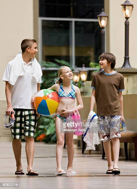 Young children walking to the pool