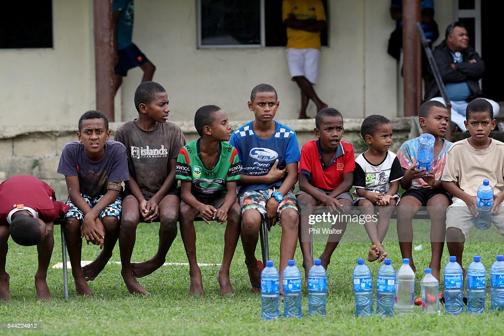 Young children watch the action during the Fiji Schoolboy Rugby match between St Stanislaus College and Andhra Secondary School on July 2, 2016 in Nadi, Fiji.