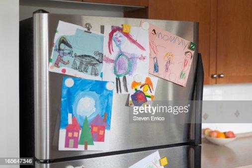 Young child's art on fridge door