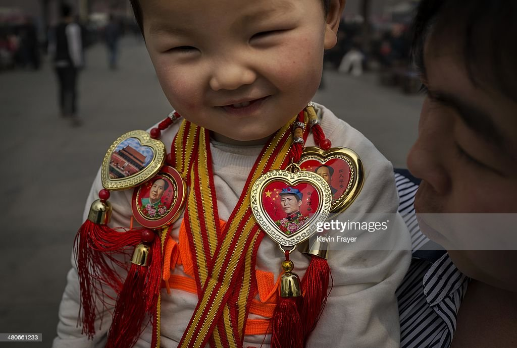 A young Chinese boy wears trinkets showing the image of the late Chairman Mao Zedong, the founder of the People's Republic of China on March 26, 2014 in Beijing, China. As the capital of the People's Republic of China, Beijing is one of the most populous cities in the world at over 21 million people.