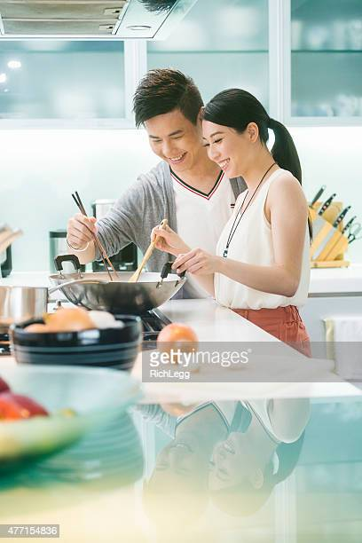 Young Chinese Couple in Kitchen