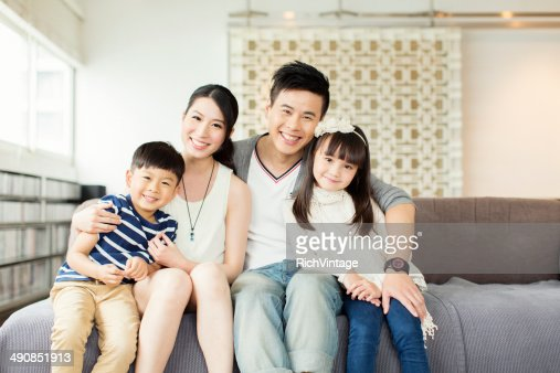 Young Chinese Family in Apartment