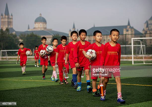 Young Chinese football players walk to training at the Evergrande International Football School on June 13 2014 near Qingyuan in Guangdong Province...