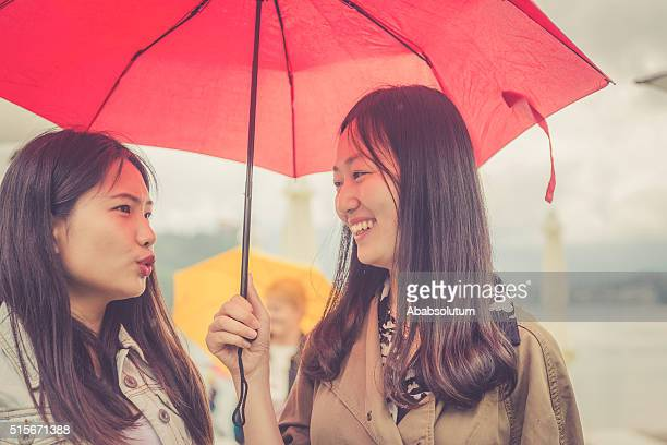 Young Chinese Friends Talking, Rainy, Bled, Slovenia, Europe