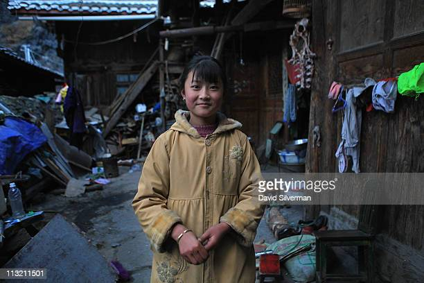 A young Chinese girl stands in the yard of her family's home on December 4 2010 in Songpan in China's Sichuan province The ancient city of Songpan...