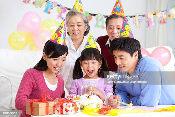 Young Chinese girl's birthday with family