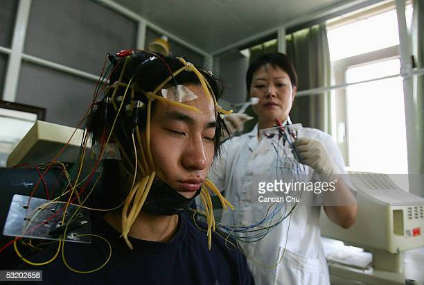 A young Chinese internet addict receives an electroencephalogram check at the Beijing Military Region Central Hospital July 6 2005 in Beijing China...
