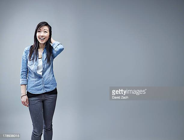 Young Chinese woman laughing, portrait