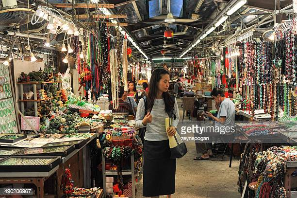 Young Chinese woman shopping at the jade market