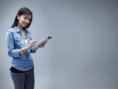 Young Chinese woman using digital tablet