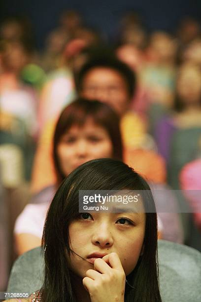 Young Chinese women watch 'Super Girl Voice' during the show's recording at Hunan Satellite TV station on June 21 2006 in Changsha city Hunan...