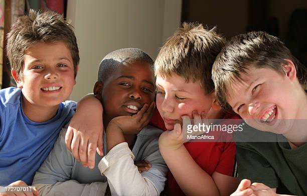 Young classmates laughing together