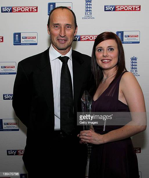 Young Coach of the Year Award winner Lizzie Harrison pose with Nasser Hussain during the ECB Awards at Lords on December 10 2011 in London England