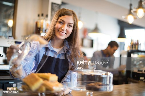 young coffee shop waitress shows off her flapjacks
