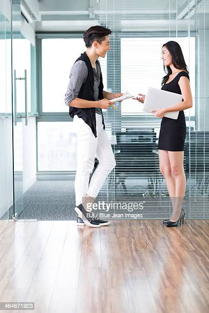 Young colleagues talking in office