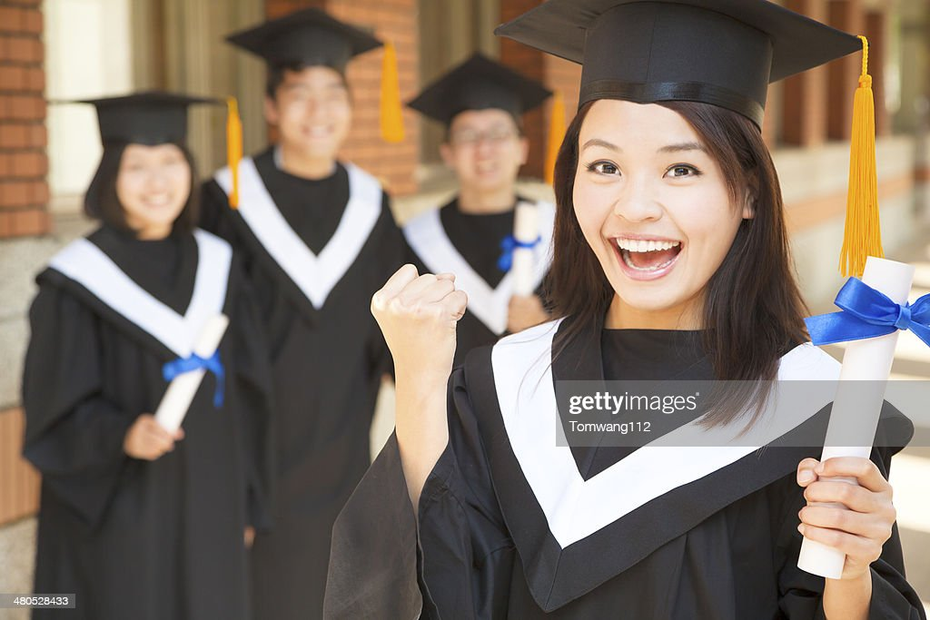 young college graduate holding diploma  and make a fist : Stock Photo