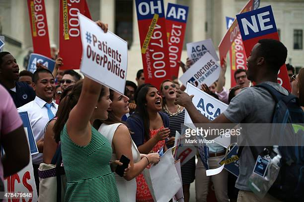Young college students celebrate in front of the US Supreme Court after a ruling was announced in favor of the Affordable Care Act June 25 2015 in...