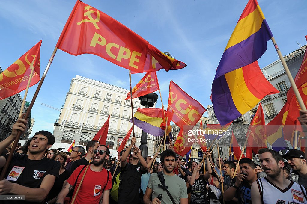 Young communists call for an end to the Spanish monarchy during a demonstration on June 2, 2014 in Madrid, Spain. King Juan Carlos of Spain has renounced the throne after 39 years and will be succeeded by his son Prince Felipe of Spain.