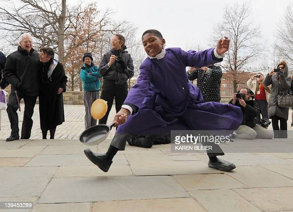 A young competitor loses his pancake while running his heat February 21 2012 during the annual Washington National Cathedral Pancake Race in...