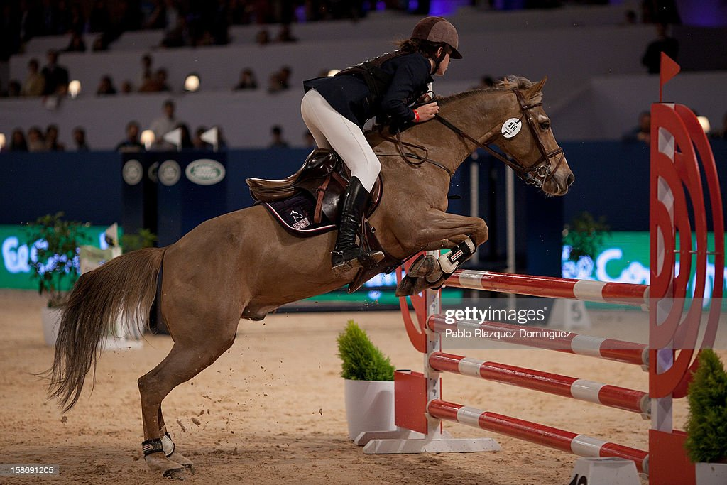 A young competitor rides her horse during Madrid Horse Week Fair at Ifema on December 23, 2012 in Madrid, Spain.