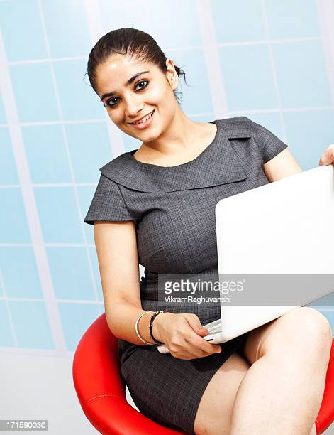 Young Confident Attractive Indian Businesswoman Using Laptop