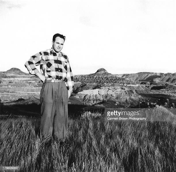 Young confident man standing on hill side