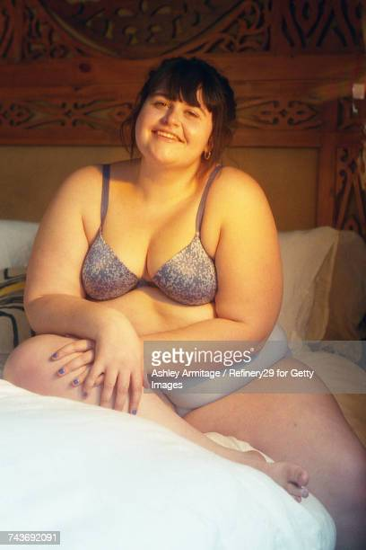 Young Confident Woman In Bedroom