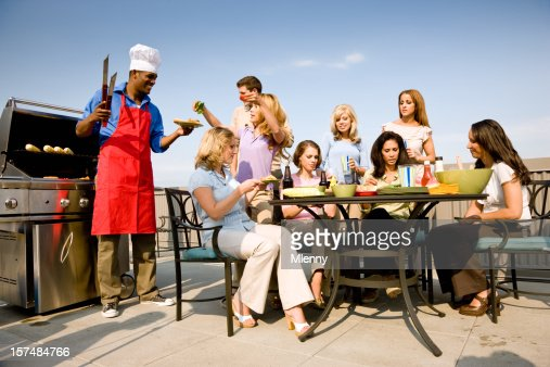 Young Cook and his Friends together at a BBQ Party