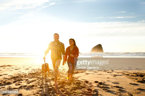 Young coupe enjoying a day at the beach. : Stock Photo