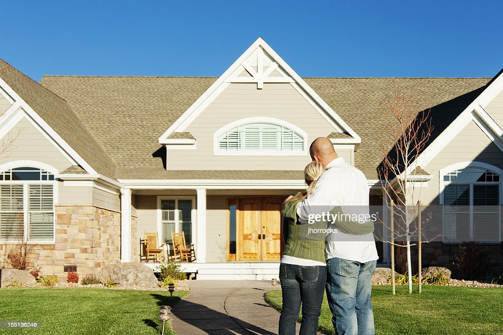 Young Couple Admiring Their New Home